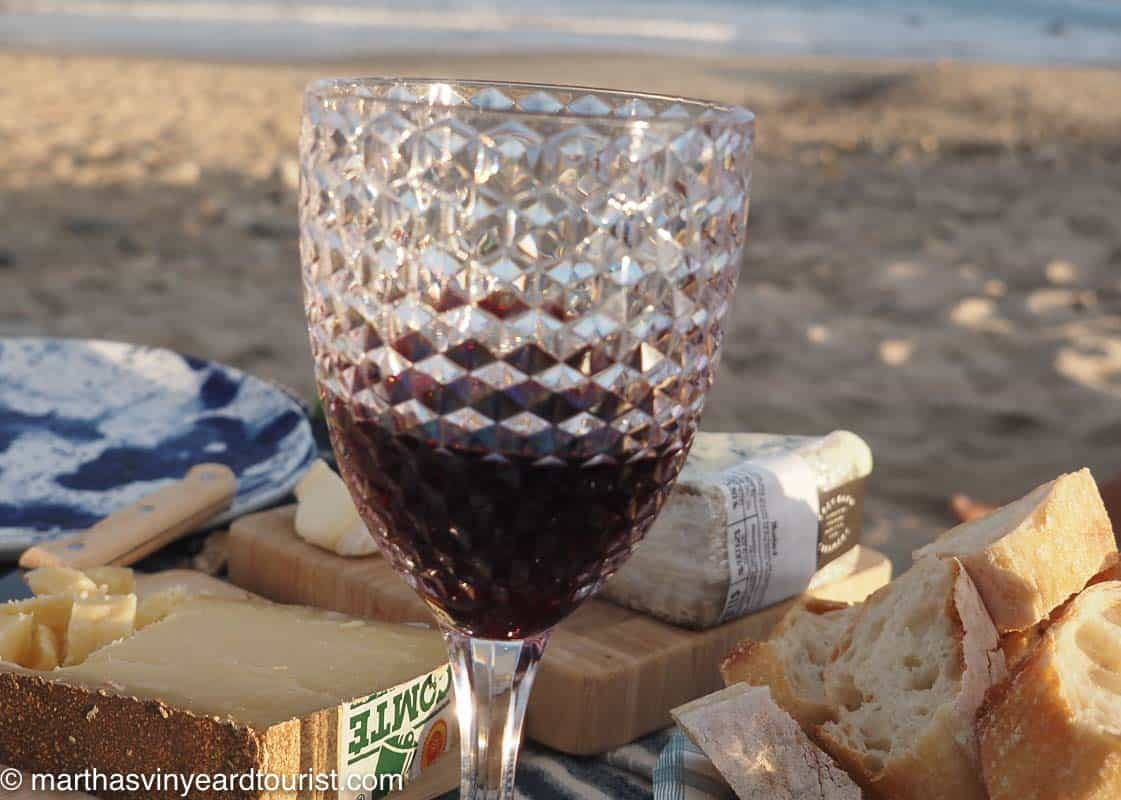 cheese from Grey Barn Farm and red wine at a beach picnic