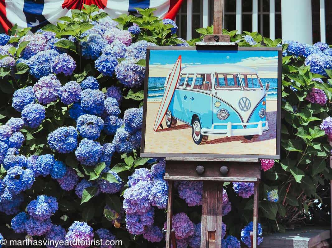 A piece of art surrounded by hydrangea located outside of an art gallery in Edgartown, Massachusetts