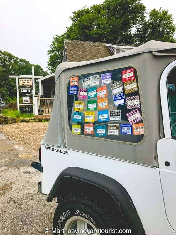An island car festooned with beach stickers collected over the years.