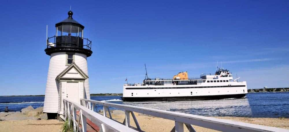 ferry to Nantucket harbor passing by Brant Point Lighthouse