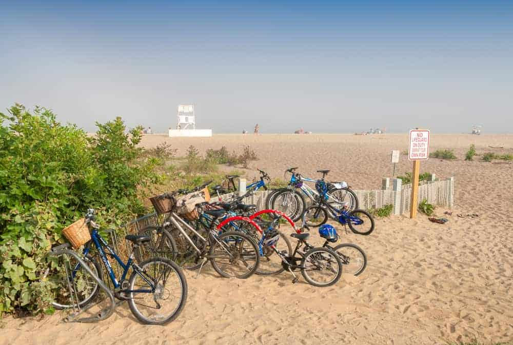 Parked bicycles on the beach in summer.