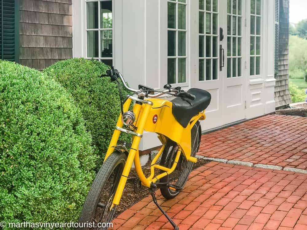 bike in front of white French doors