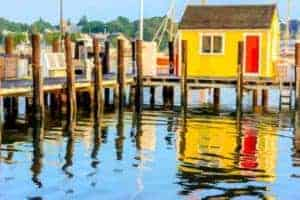 bright yellow shack on water.