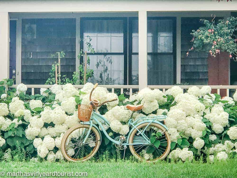 a beautiful traditional bike in front of a porch