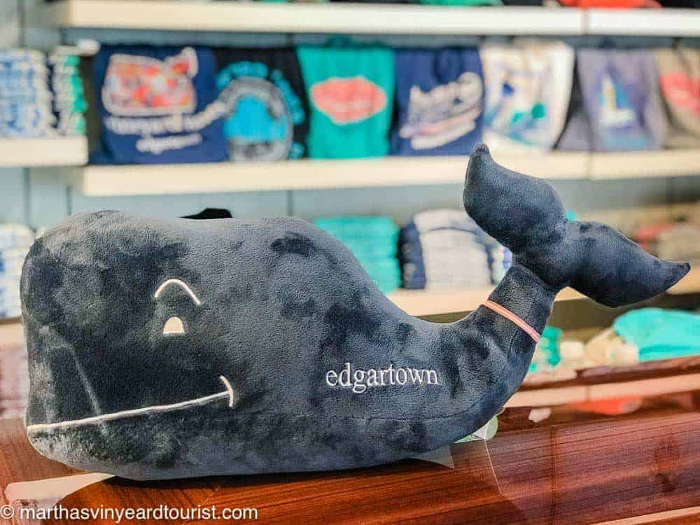 A stuffed whale toy with the words Edgartown in a store