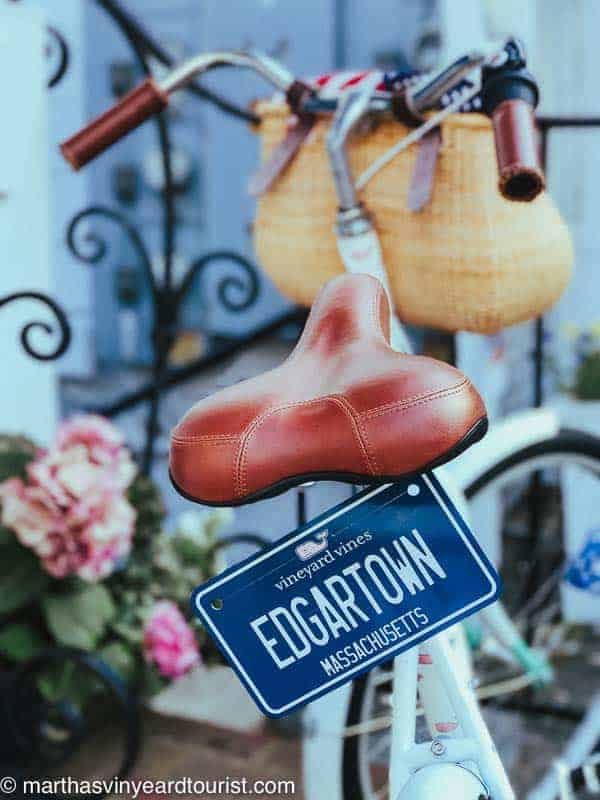 A bike plate with the words Edgartown attached to a classic bike with basket