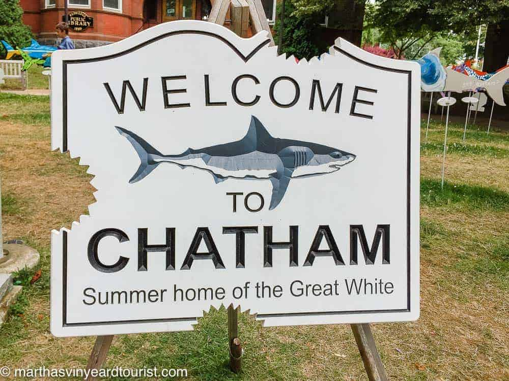 A welcome to Chatham sign with shark bite marks