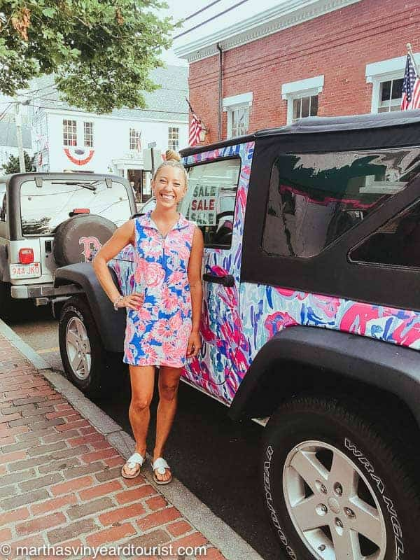 A Lily Pulitzer employee posing in front of a Lily Pulitzer jeep