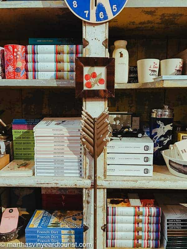 a shelfie of books and other items in a store