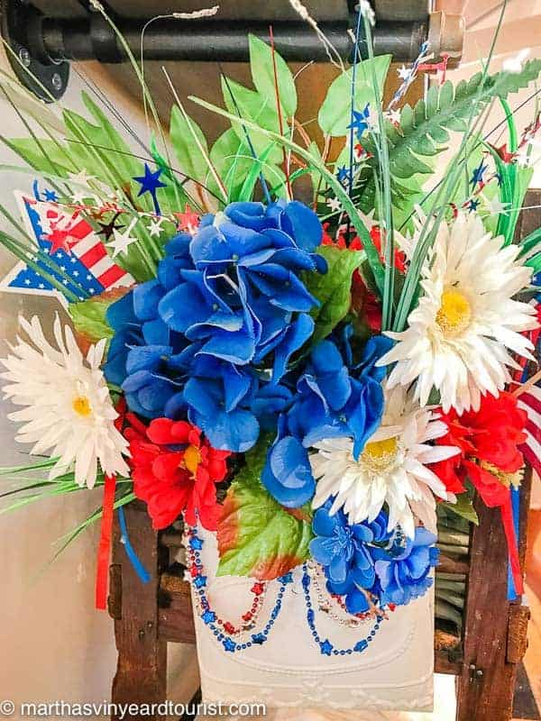 flowers and flags in patriotic July Fourth setting