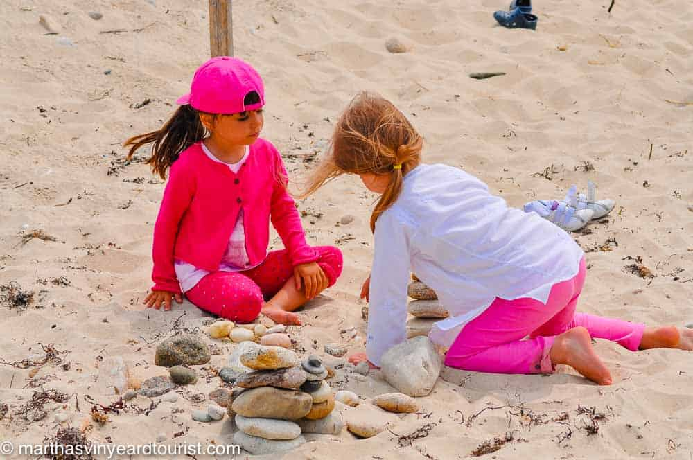 two girls collecting stones on the beach