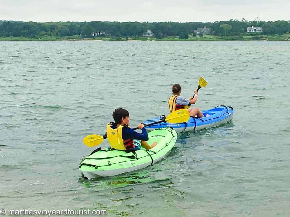 two kids kayaking Sengekontacket Pond Martha's Vineyard