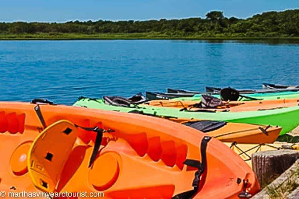 Colorful kayaks line a Martha's Vineyard Pond