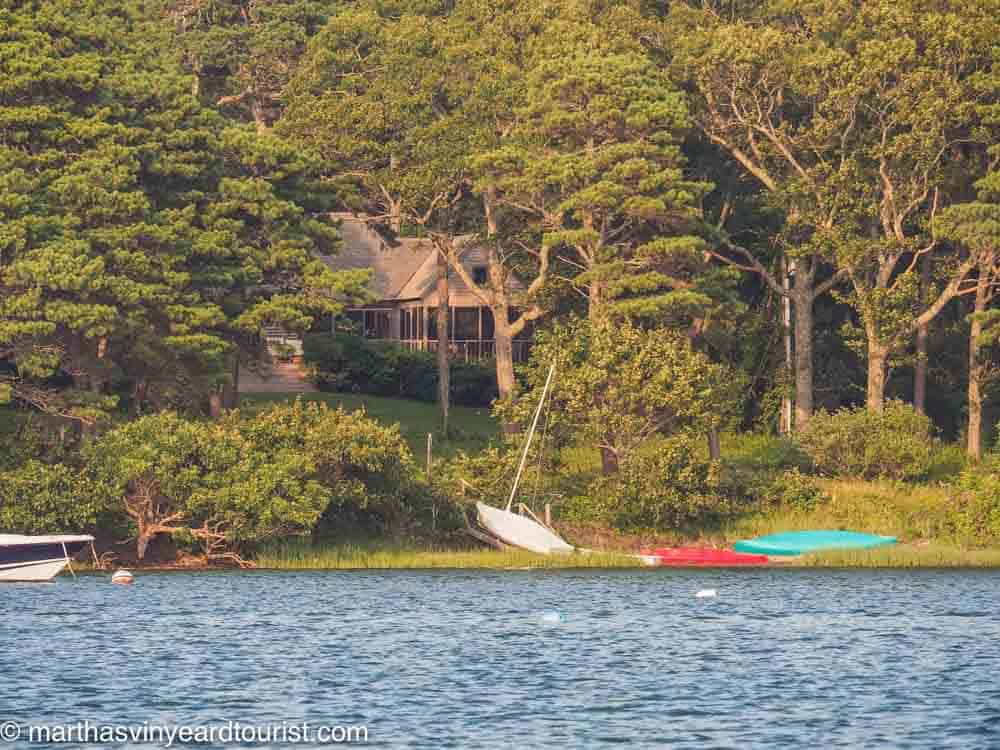 kayaks in the water by a house