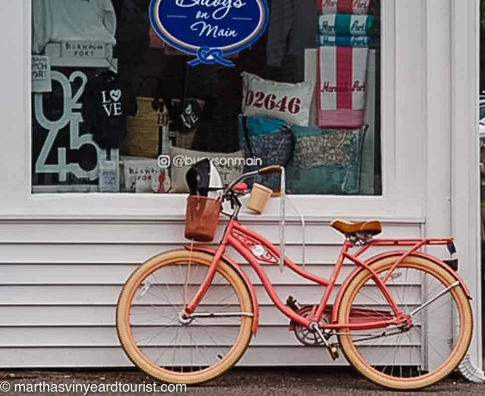 pink bike leaning against a Cape Cod store