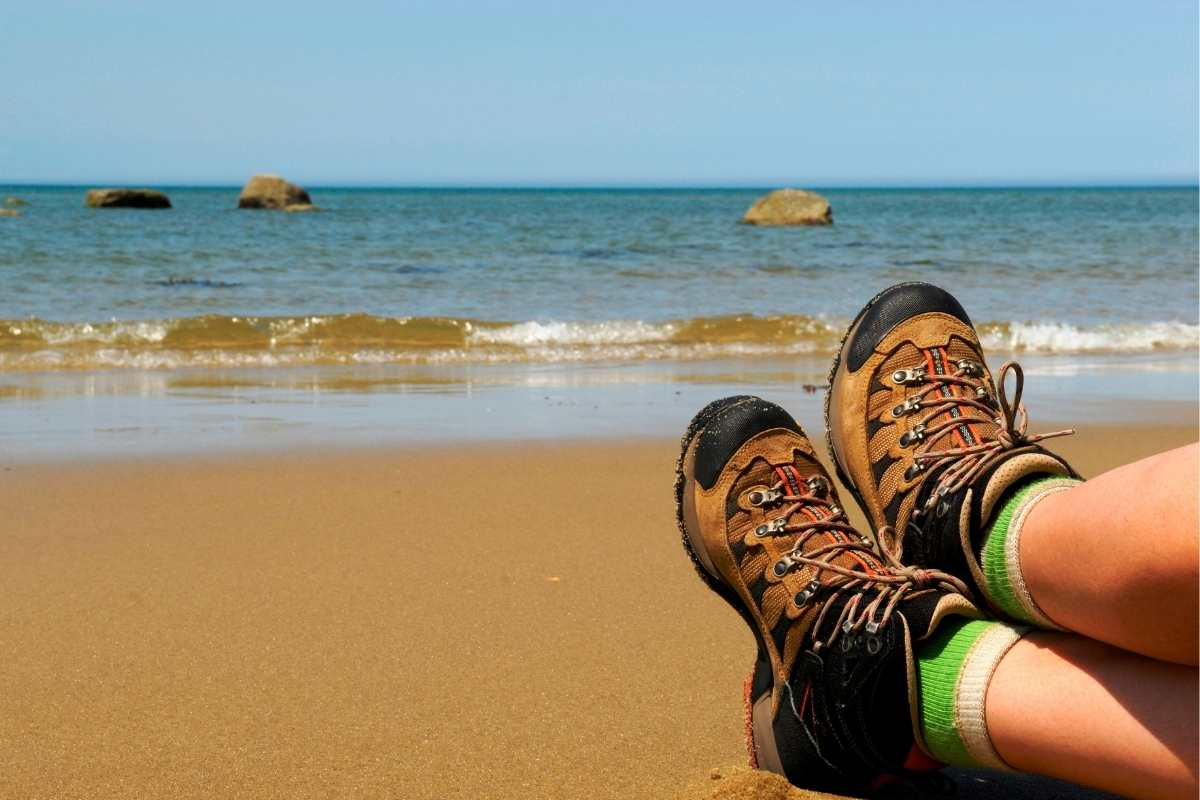 someone sitting with hiking boots at Cape Cod National Seashore