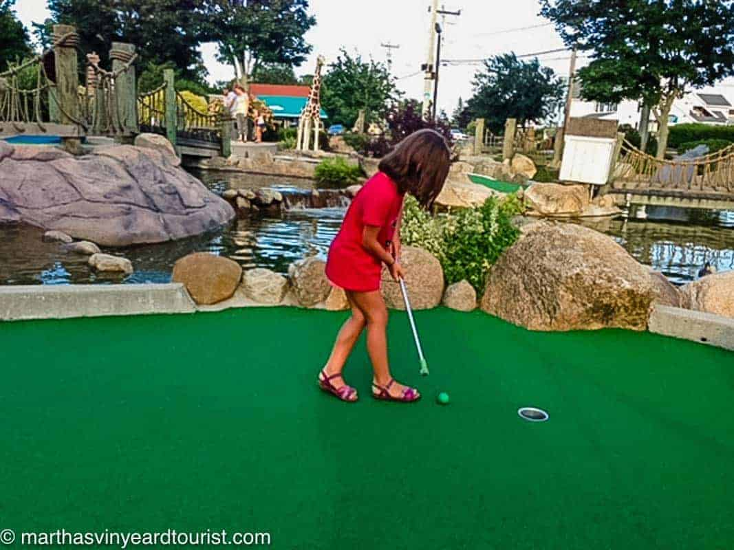 Cape Cod mini golf and girl playing