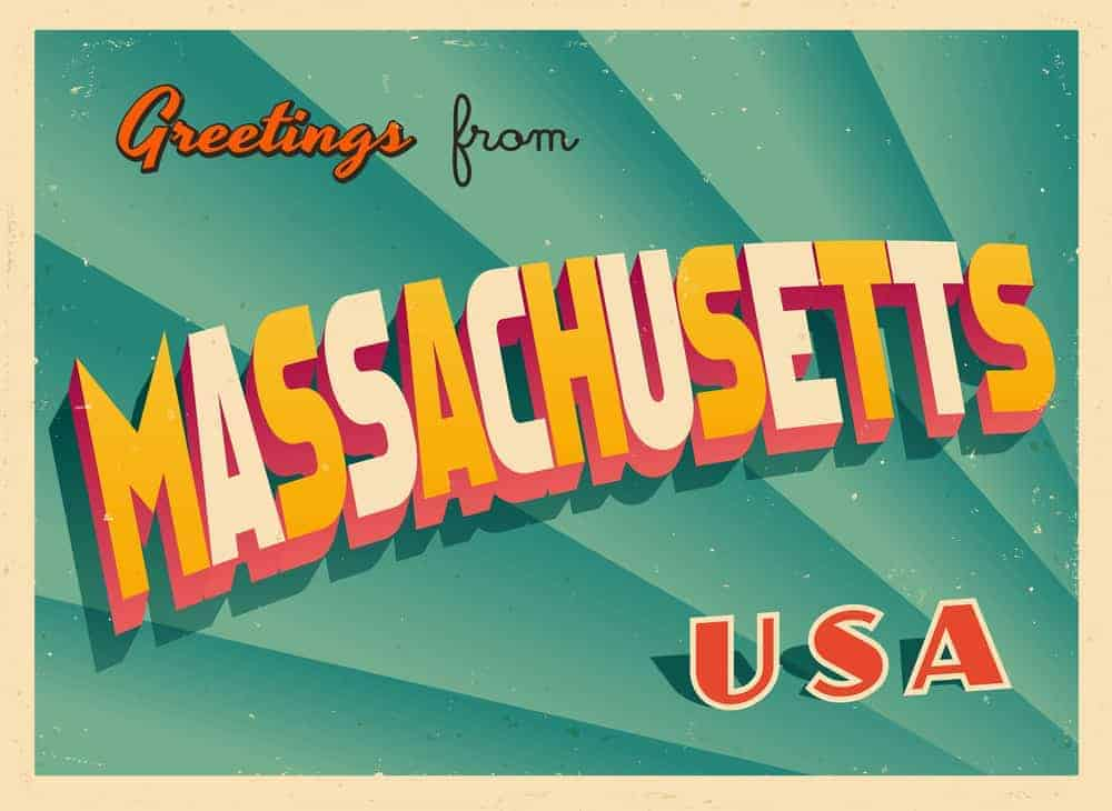 "green postcard with the words: ""Greetings from Massachusetts U.S.A.'"