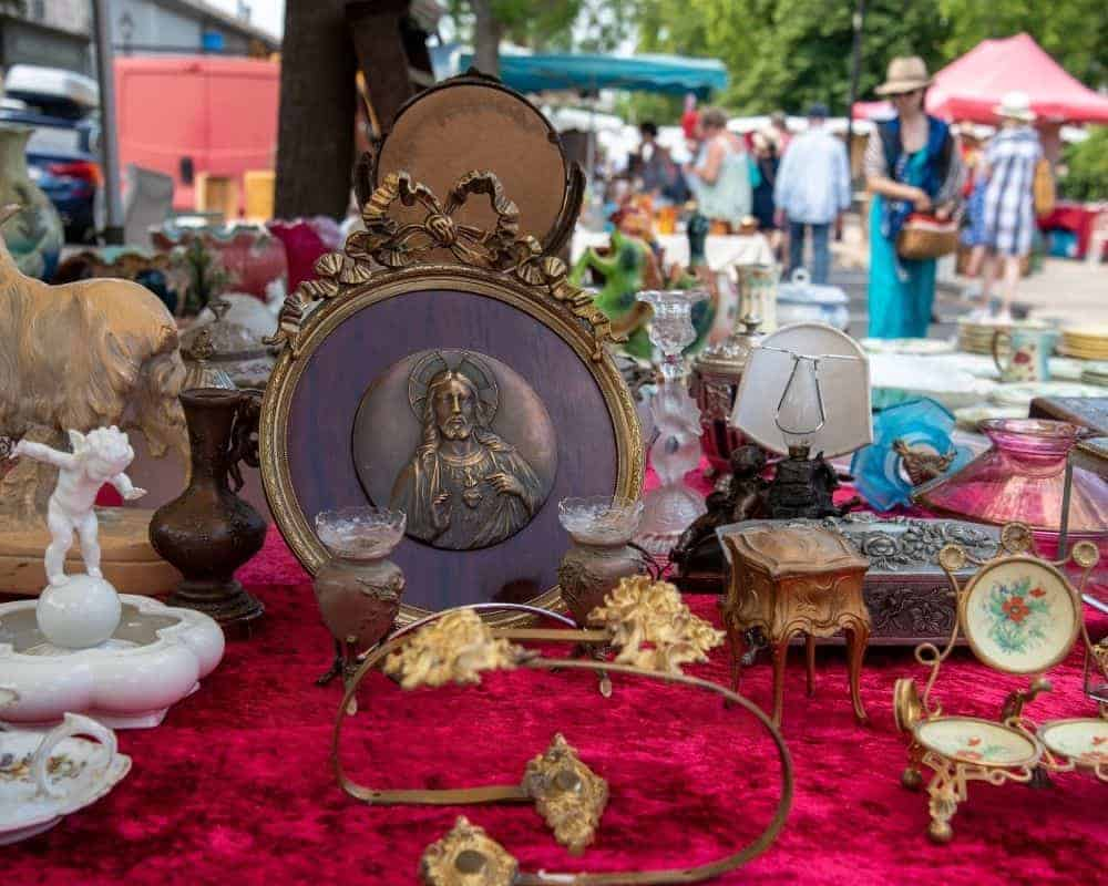 an antiques fair with passerby in the background
