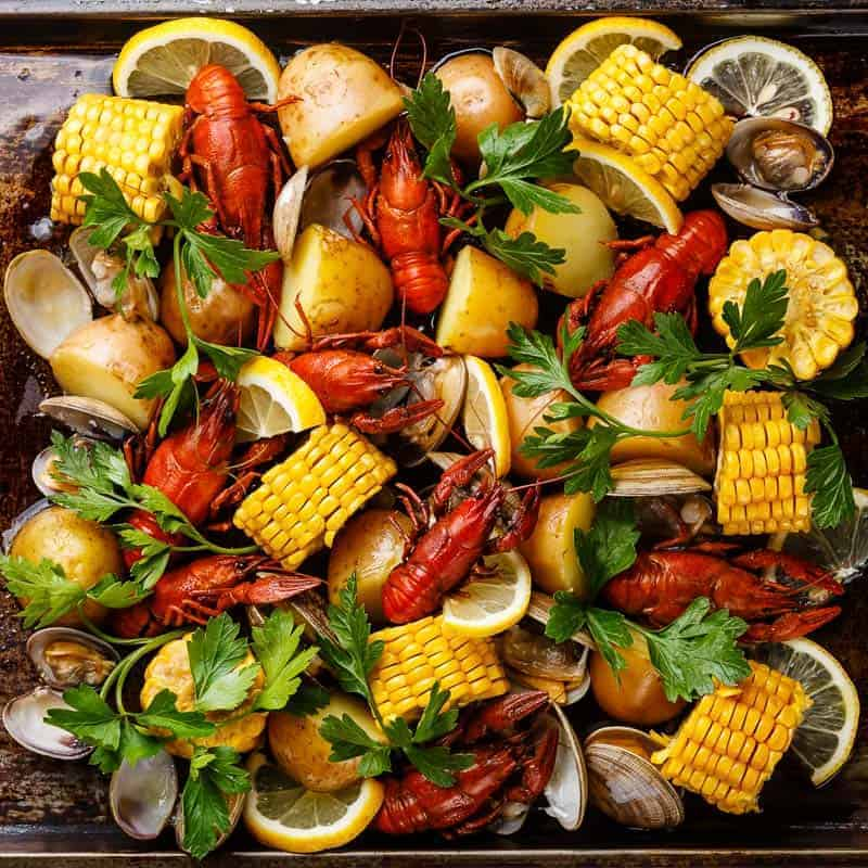 clambake with lobster, clams and corn on the cop