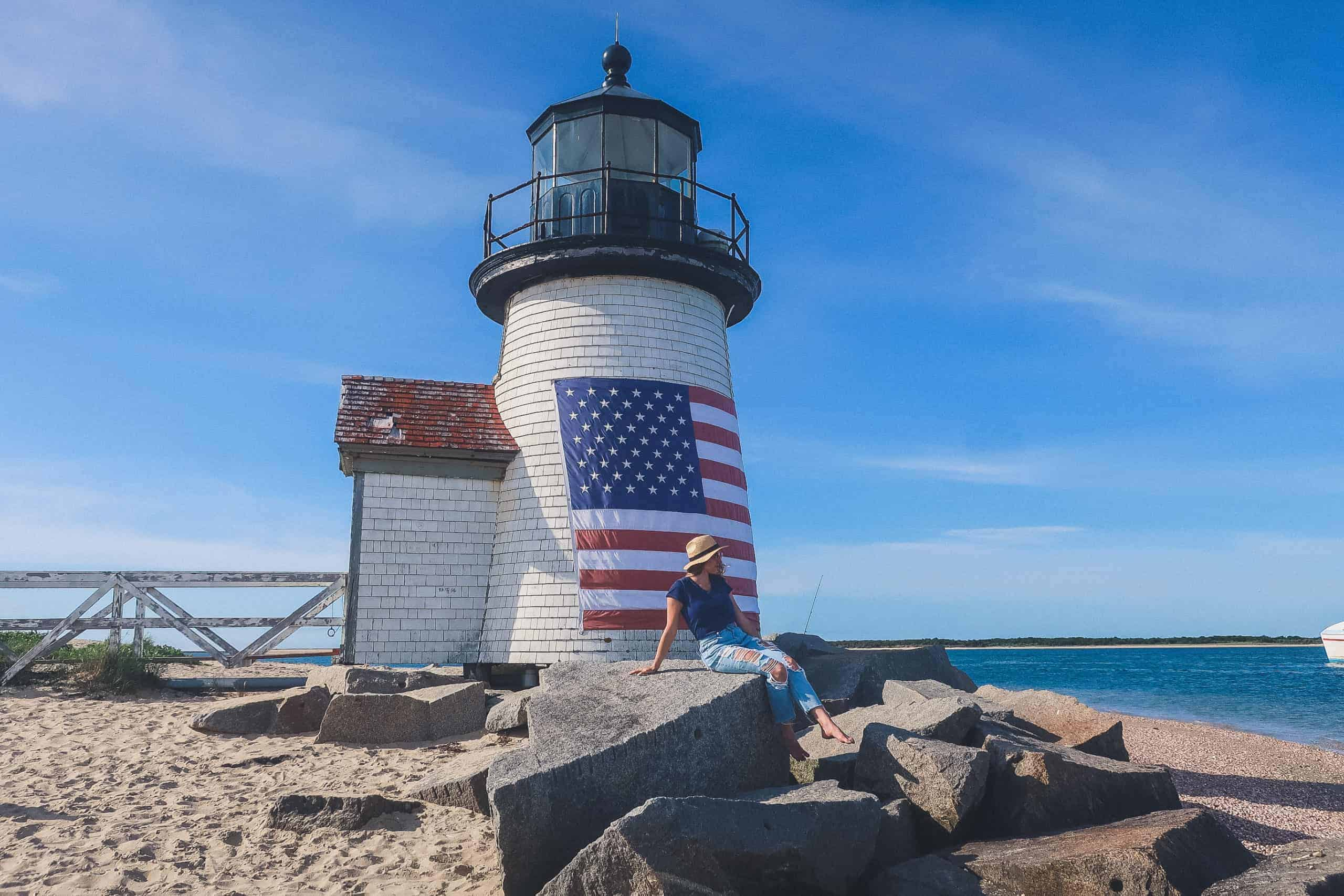 white lighthouse in Nantucket with the American flag painted on it