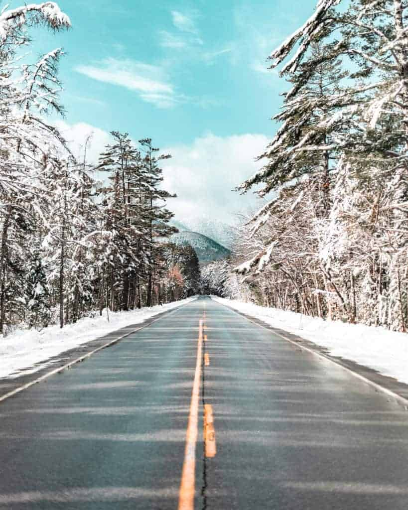 snowy forest and road on Kancamagus Highway
