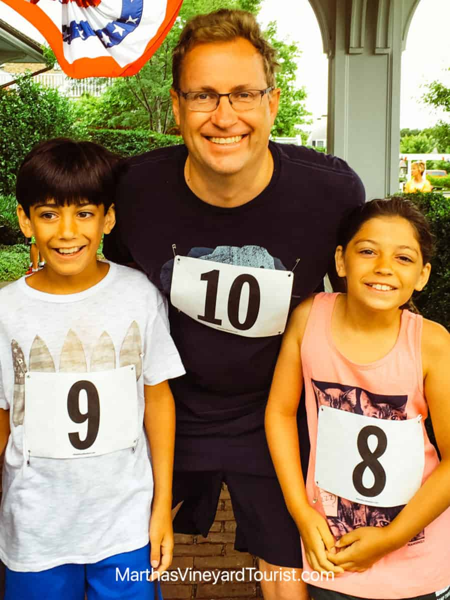 man. boy and girl with number identifiers for a road race