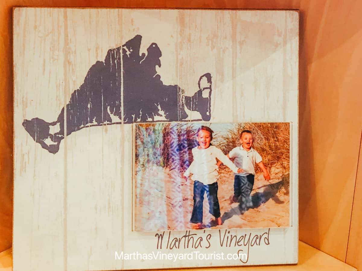 picture frame depicting the island of Martha's Vineyard and a photo of children running
