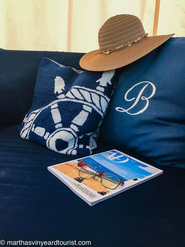sunhat and a magazine in a cabana at the pool