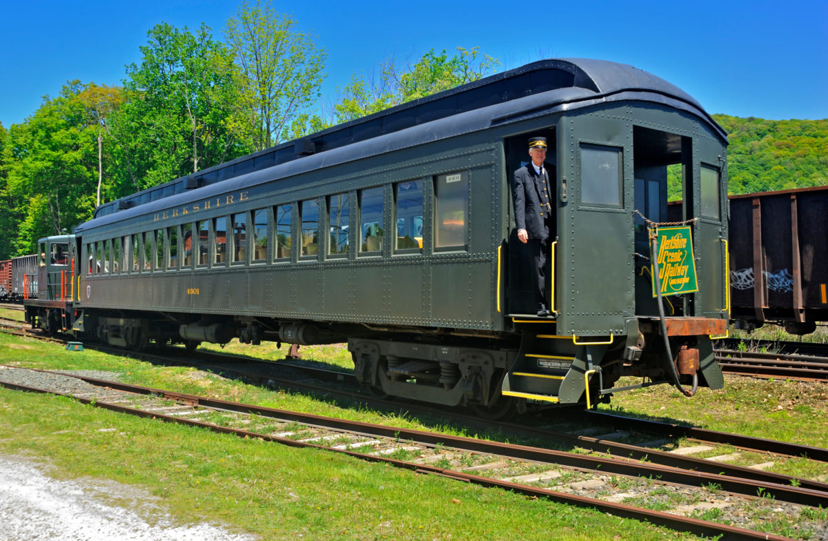 an old train car on the Berkshire Scenic Railway with a conductor at the door
