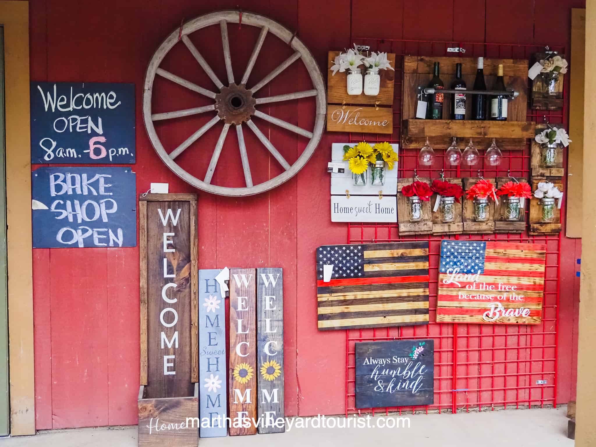 red farm store porch with welcome porch signs
