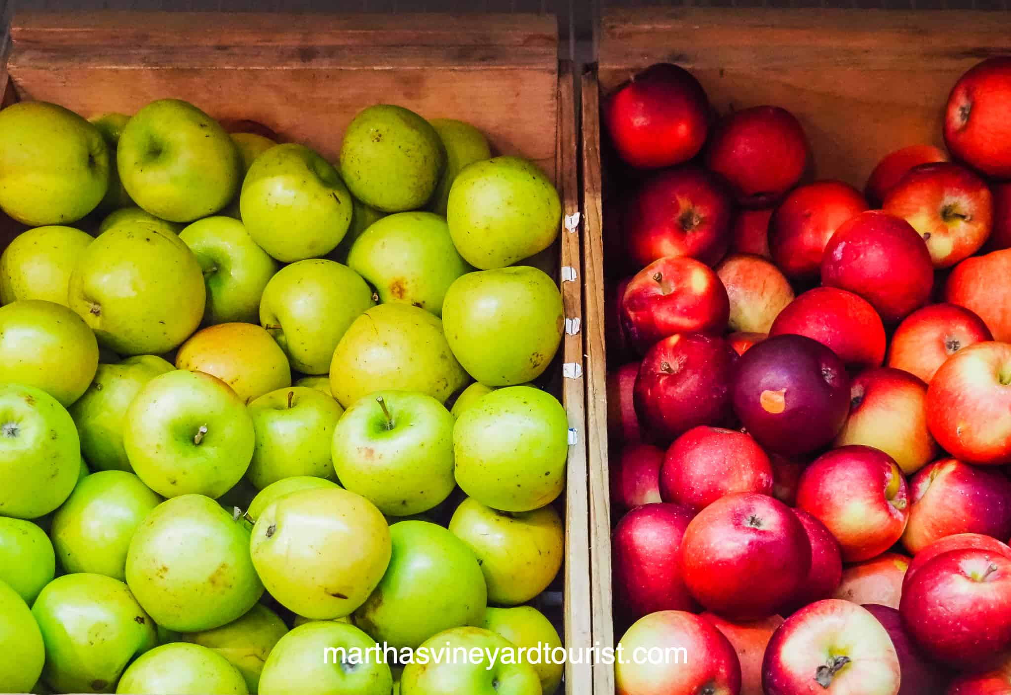 red and green apples in crates