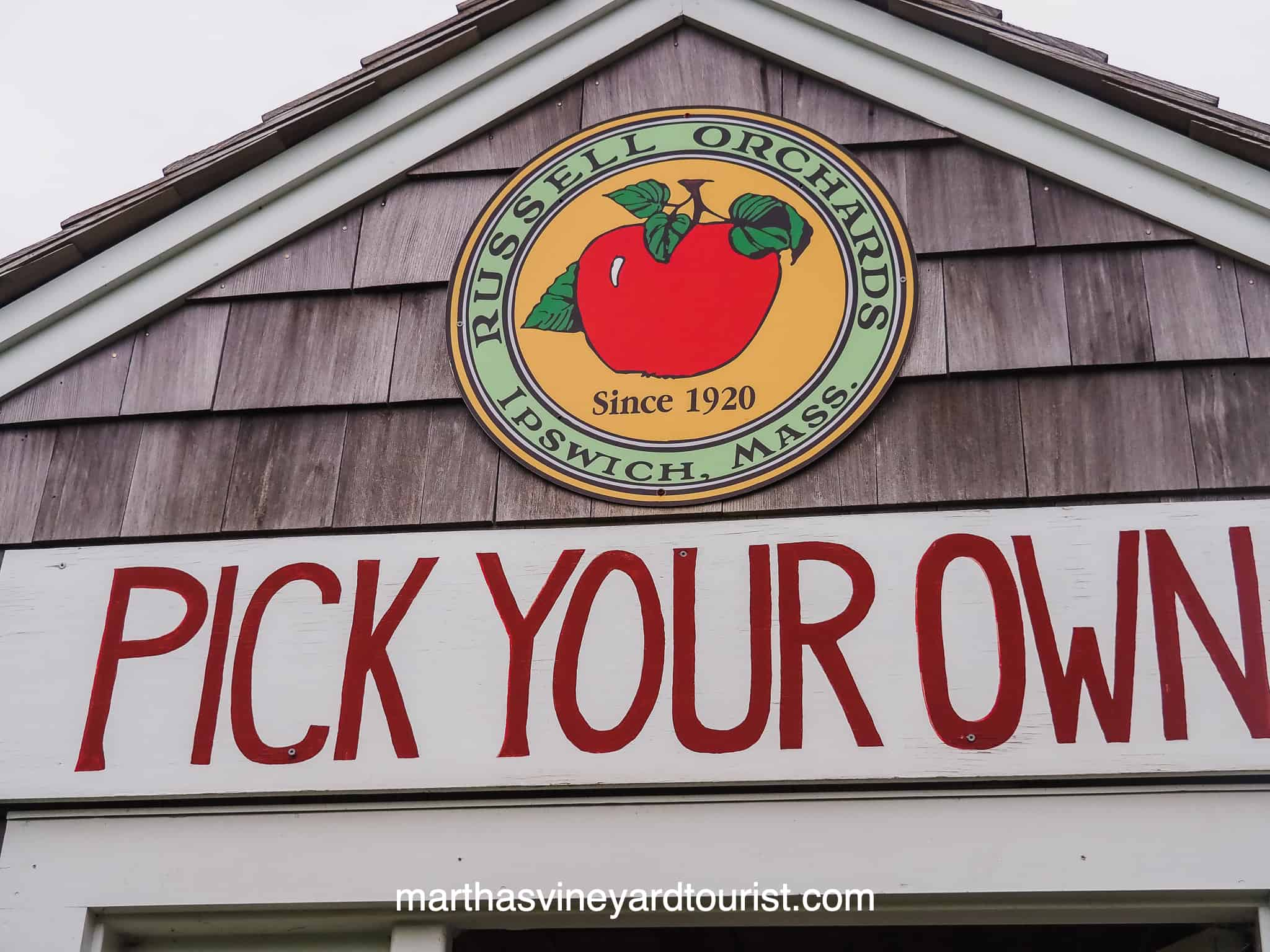 a sign for pick your own fruit at Russell Orchards a Massachusetts Farm