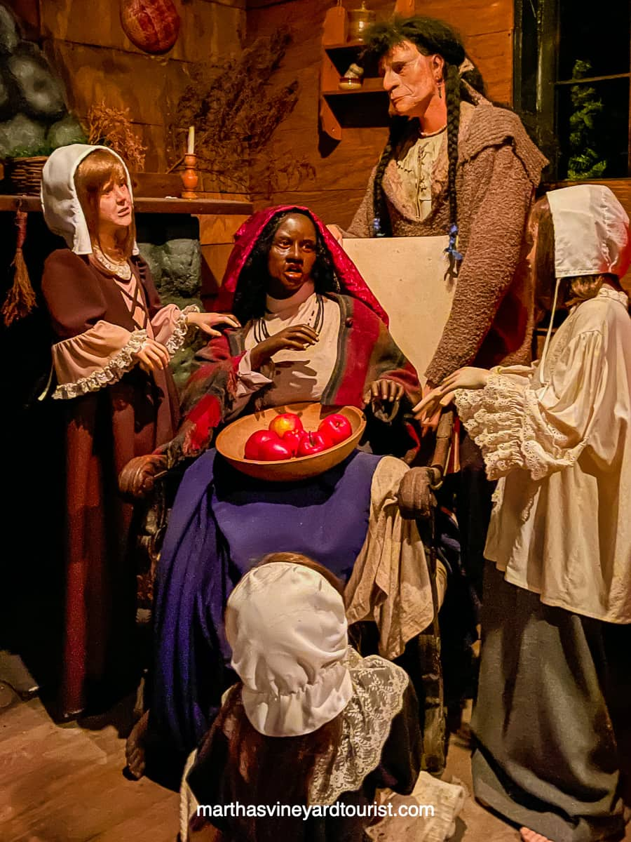 A diorama of Tituba telling tales to the Salem girls